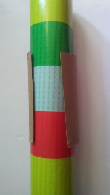 A toilet paper tube holding wrapping paper closed.