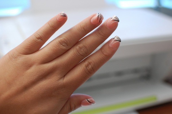 A hand with press-on nails applied.