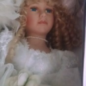 Value and Information for Porcelain Doll - closeup of face