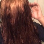 Dyed hair with lighter roots.