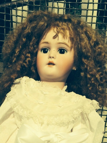Finding the Value of an Antique German Doll - doll with curly dark hair
