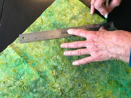 Clothespin Apron - drawing lines on green batik for bias binding