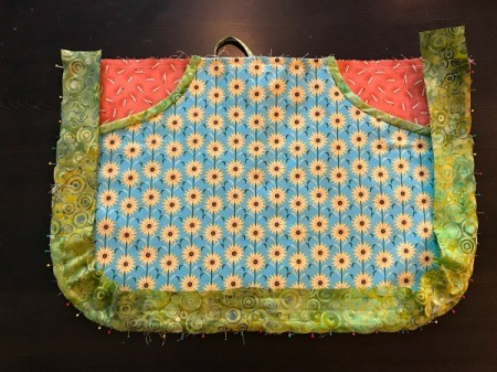 Clothespin Apron - bias binding pinned to apron by removing pins and resetting