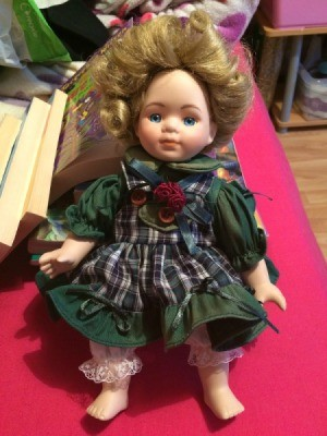 Identifying a Porcelain Doll - wearing green dress with plaid apron