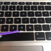 Cleaning a laptop keyboard with an interdental brush.