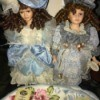 Collectible Memories Porcelain Dolls - two dolls in fancy dresses with hats