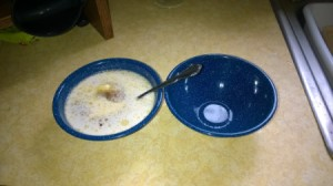 A bowl filled with food next to another empty bowl.
