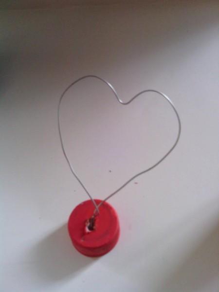 Soda Bottle Bird Feeder - wire shaped into a heart