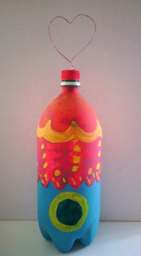Soda Bottle Bird Feeder - finished bottle with more decorative painting and ready to hang