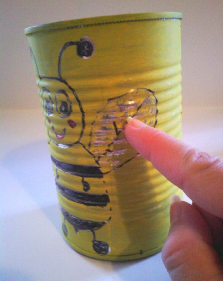 Recycled Bumblebee Can - scratching off some of the paint to reveal the metal beneath