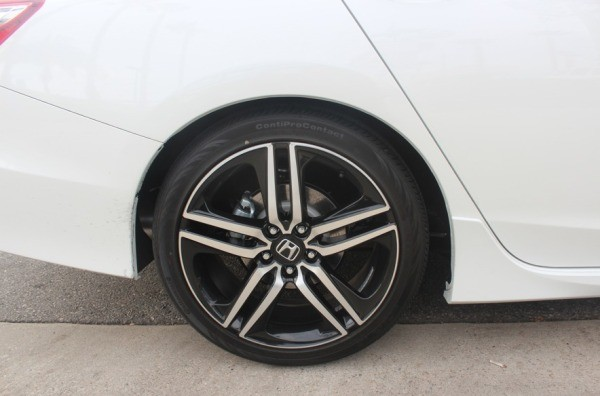 A white car's back tire.