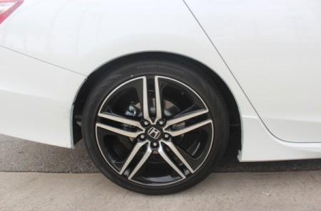 A white car's back tire.