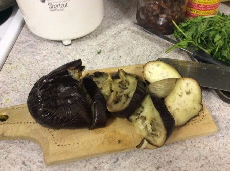 cutting the baked Eggplant