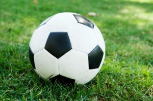 A soccer ball on grass.