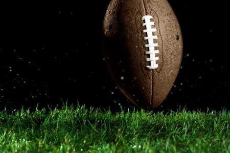 A football on grass.