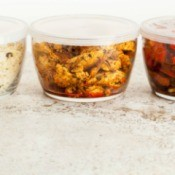 Leftovers stored in clear containers with lids.