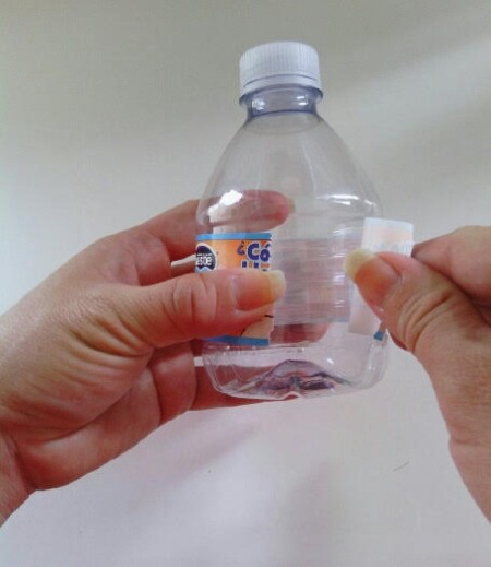 Sumo Wrestler Salt and Pepper Shakers - removing label from bottle