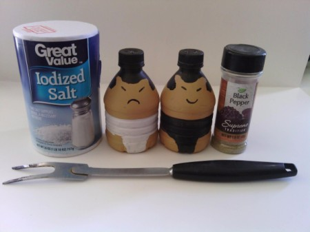 Sumo Wrestler Salt and Pepper Shakers - salt and pepper shakers and fork along with pepper and salt