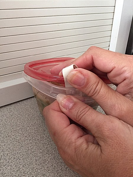 A plastic container with a rubber band sticking out, to help with opening.