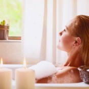 A woman taking a relaxing bath.