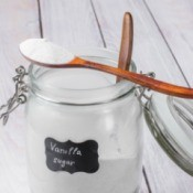 A jar of sugar that has been flavored by vanilla beans.