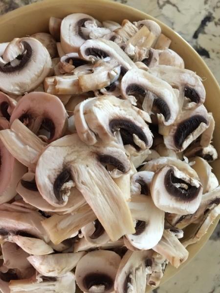 Mushrooms sliced in bowl