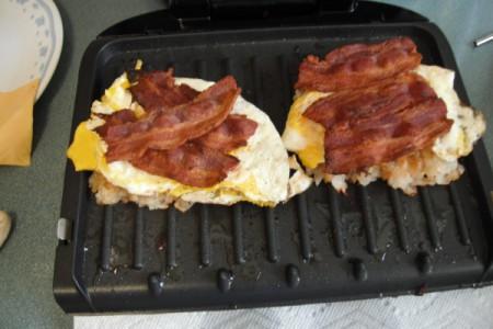 eggs and bacon on Breakfast Sandwich in grill