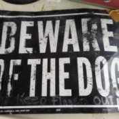 "An old metal ""Beware of the Dog"" sign."