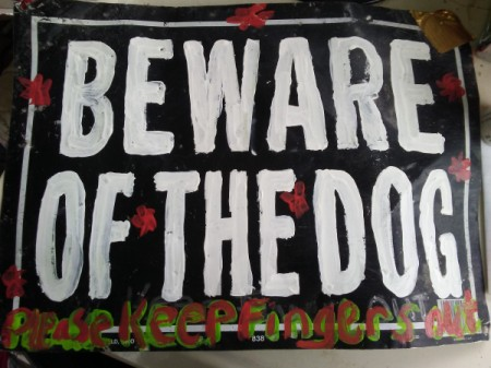 "A repainted ""Beware of the Dog"" sign."