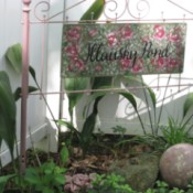 Metal Head and Footboard for Your Garden - blush headboard with sign