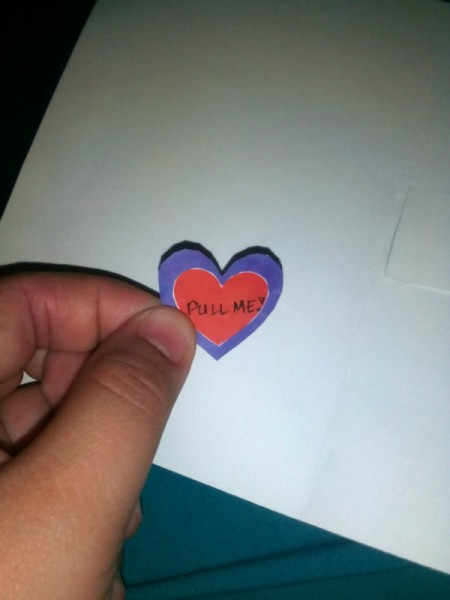 "Mother's Day Surprise Greeting Card - cut out a smaller heart and write ""Pull Me"" on it"
