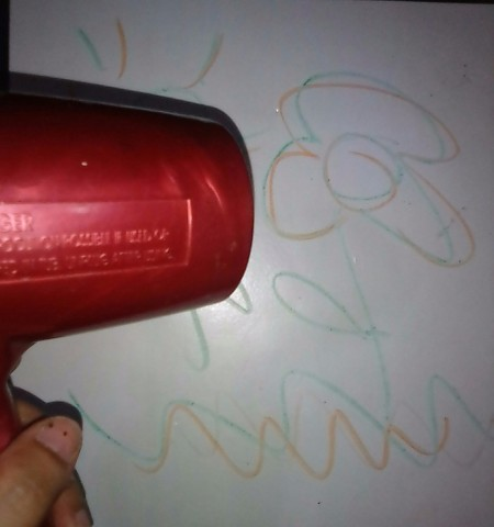 Removing Crayon Drawings from Your Wall - using hair dryer on drawings