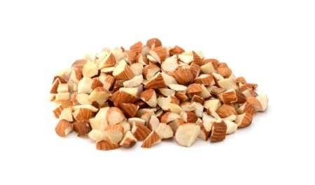 A pile of chopped almonds on a white background.