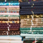 How Many Squares in a Fat Quarter? - stack of fat quarters tied with ribbons