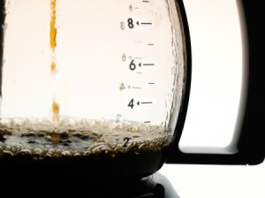 A coffeepot being filled.