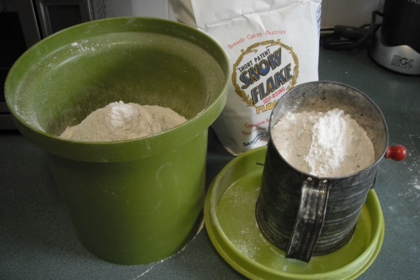 Sift Flour into Canister - avocado green canister and sifter