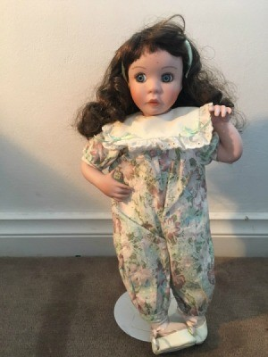 Identifying Porcelain Dolls - doll wearing one piece long leg outfit