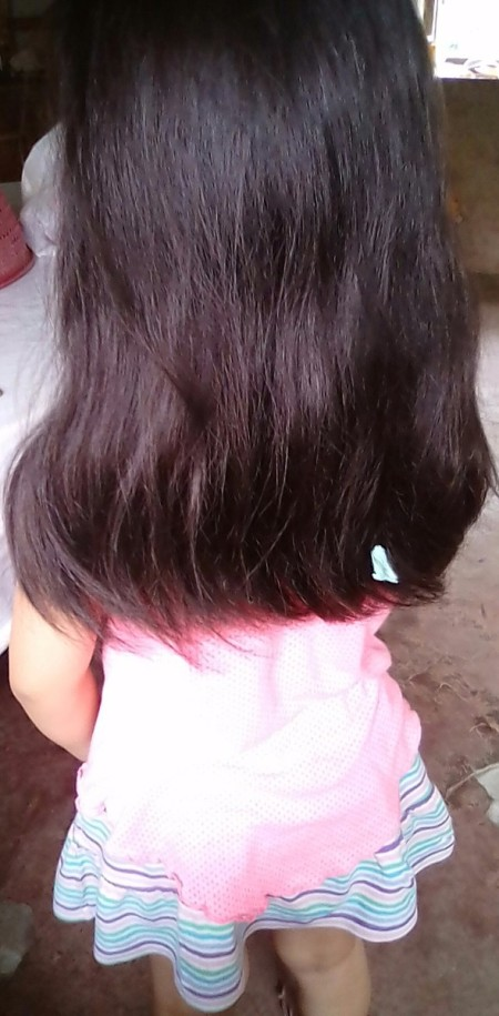 A child with gum in her hair.