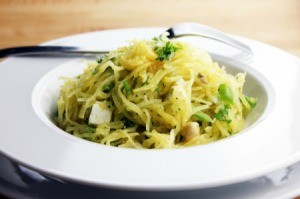 A plate of spaghetti squash with herbs and cheese.