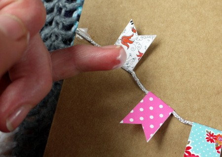 Bunting Greetings Card - add a dab of glue to keep the little flags in place