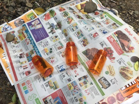 Mother's Day Pill Bottle Vases - lay clean, dry bottles on newspaper