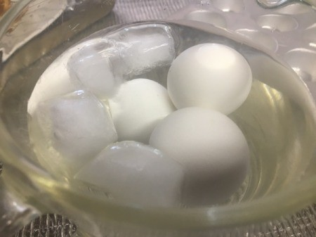 Hard cooked eggs in ice water.