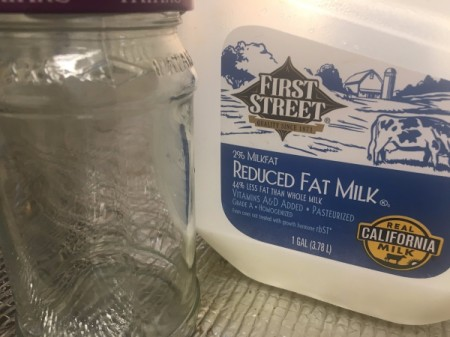 Milk and an empty glass jar.