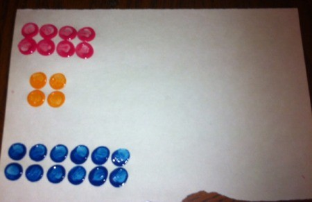 Painted Lego Math - stamping a page for teaching addition with multiple sets of two