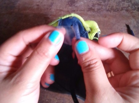 Adding tape to the end of a frayed shoelace.