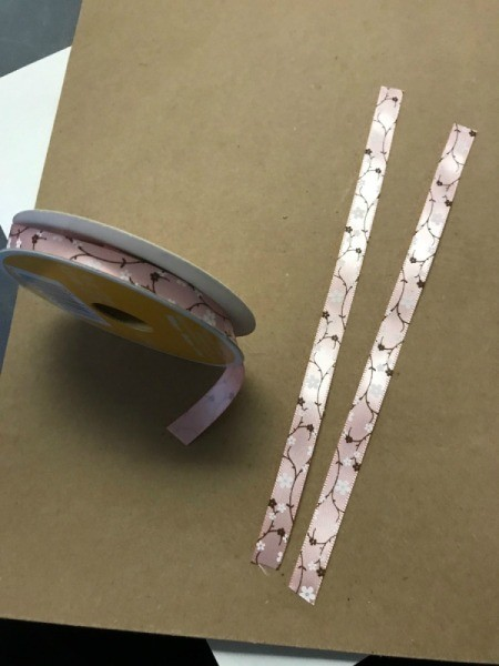 Repurpose Cylinder Container as Jewelry Stand - measure two pieces of ribbon to wrap around the ends