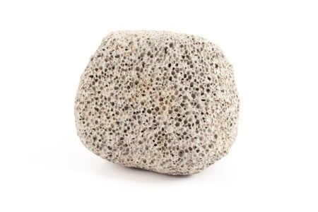 A round pumice stone, to be used for cleaning.