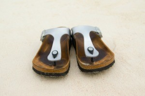 A pair of well worn Birkenstock brand sandals.