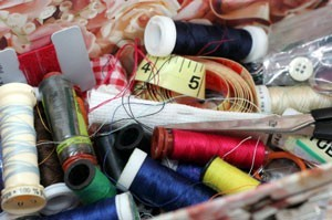 Thread and other sewing supplies in a box