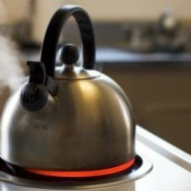 Tea Kettle Boiling on Stove